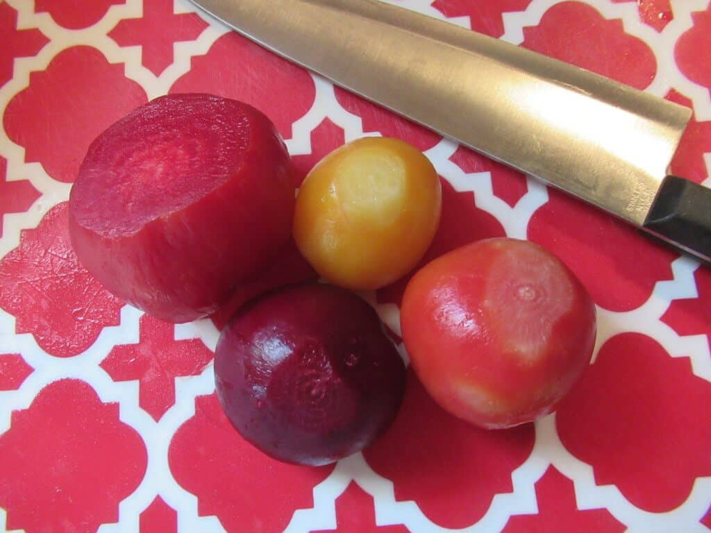 Beets, boiled and peeled with knife and cutting board