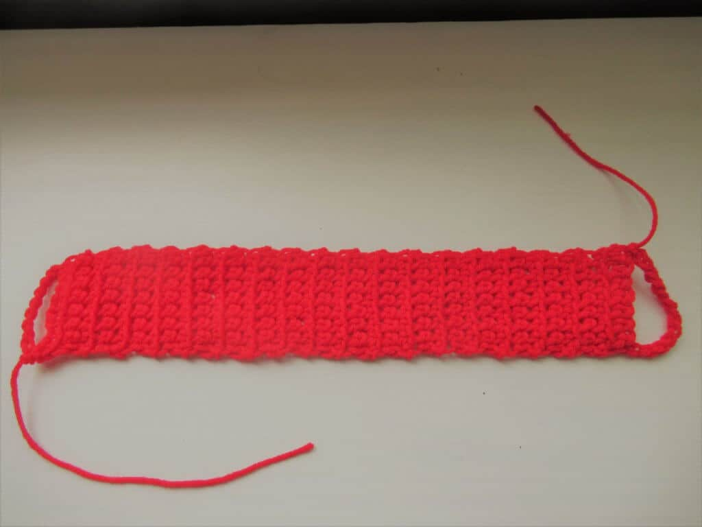 Pull the yarn through at the end