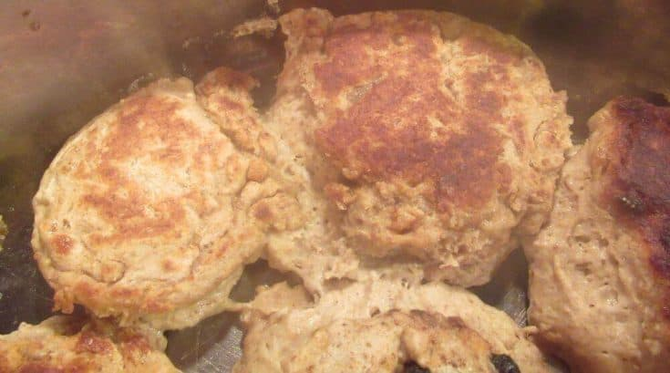 Flipped sourdough scones cooking in pan