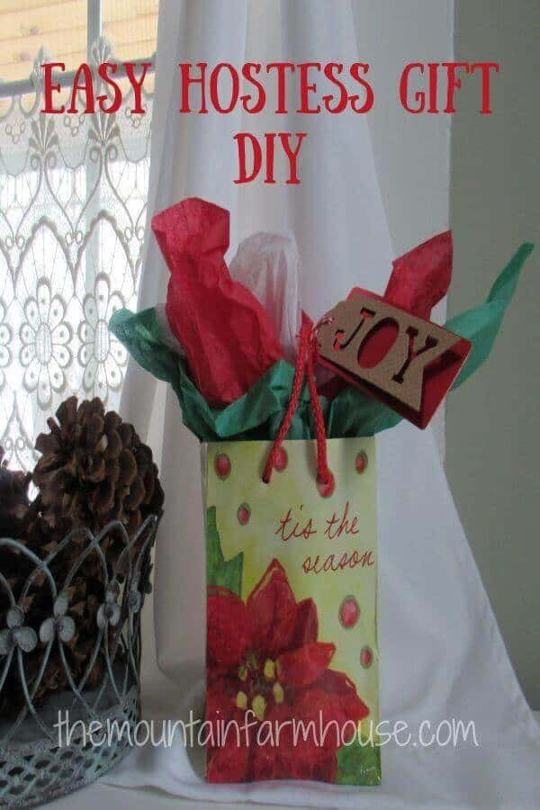 Christmas gift bag next to pine cones in window for quick easy fire starters