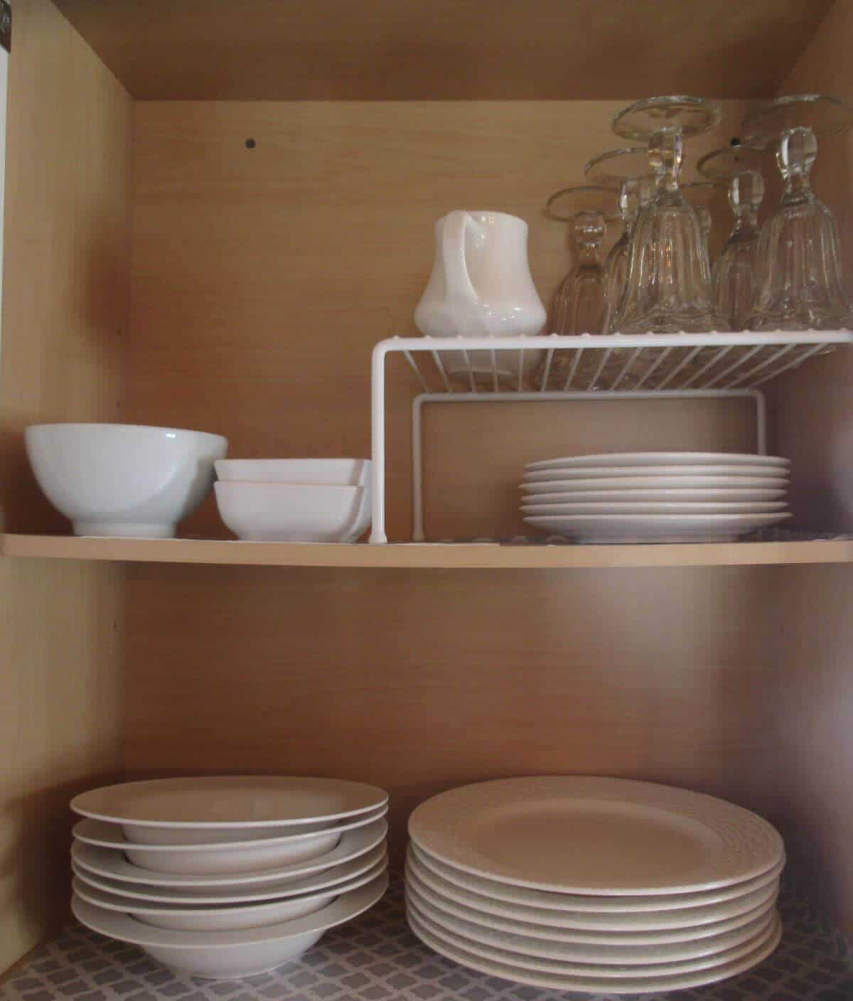 Plain white dishes in tidy cabinet