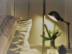 Master bed and nightstand with lamp and holiday decor