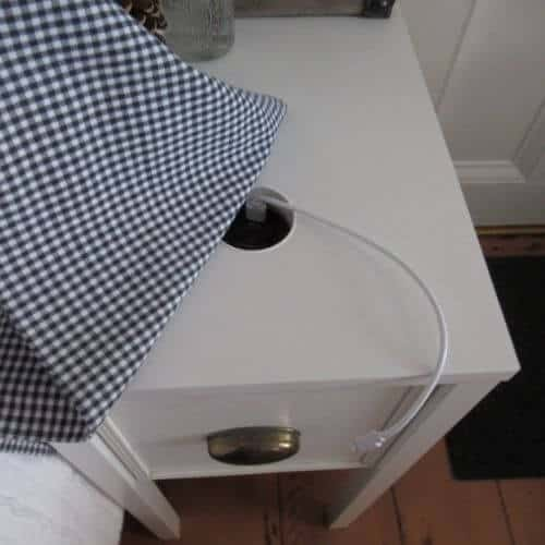 Top of nightstand with phone charger