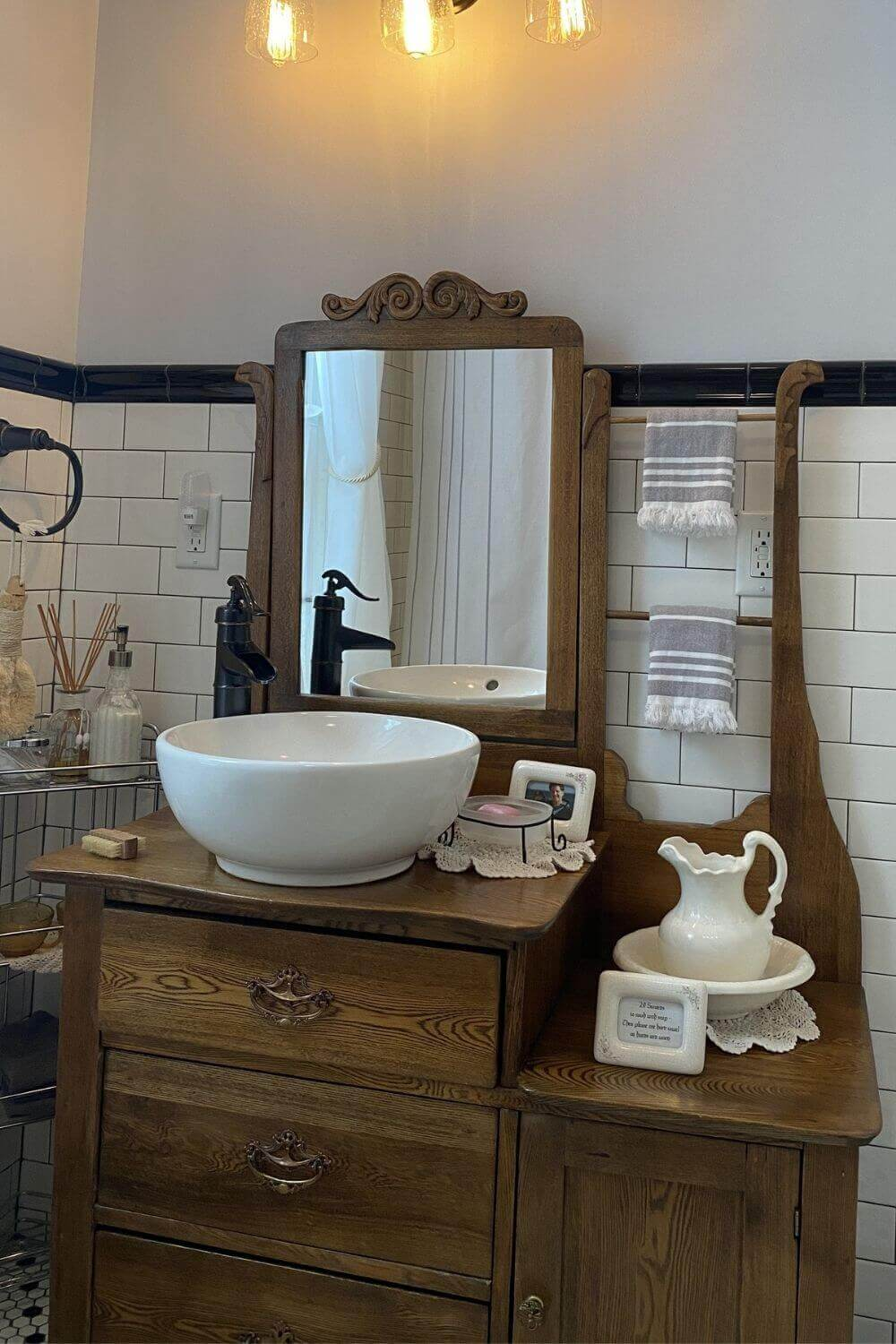 Antique sink vanity with mirror, pitcher and bowl