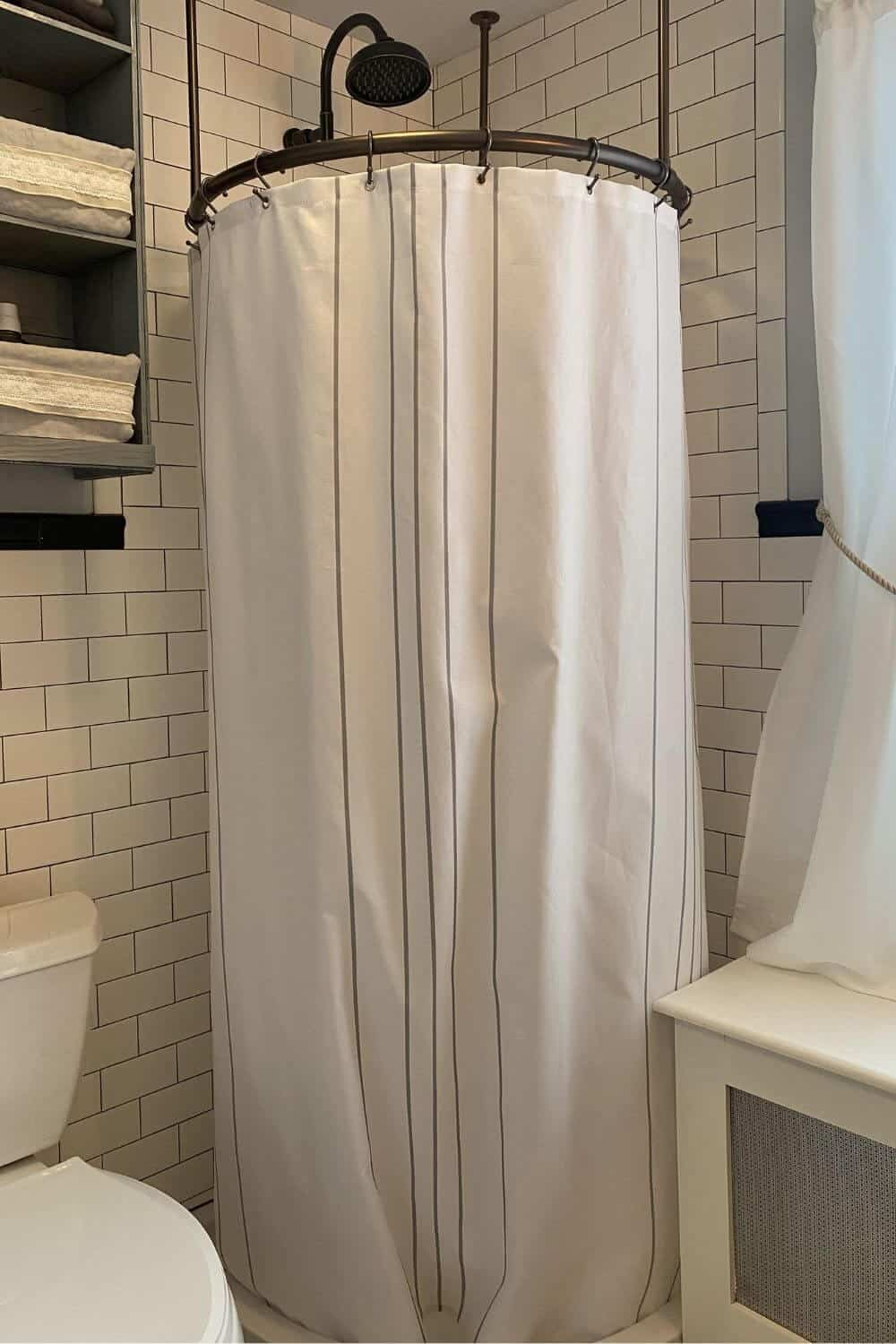White and gray striped shower curtain for corner shower stall