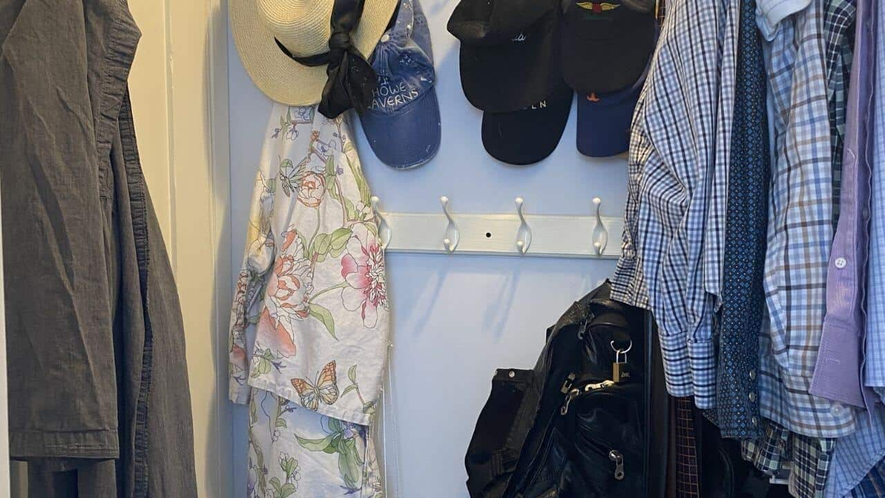 Hats, robes, bags on hooks