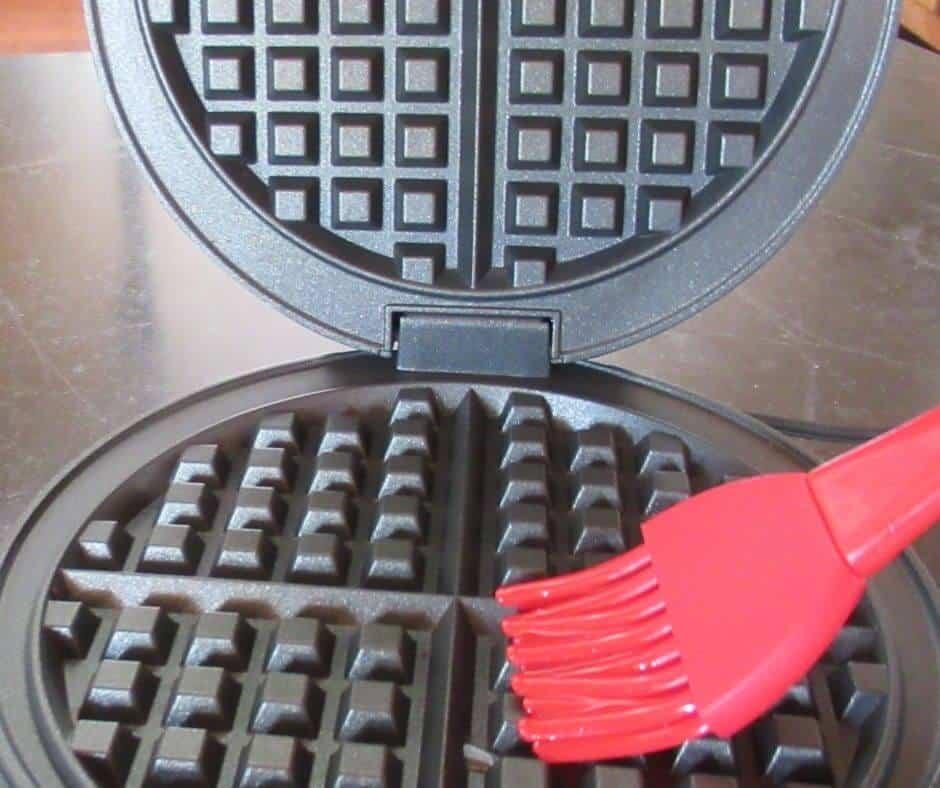 Brushing waffle iron with oil