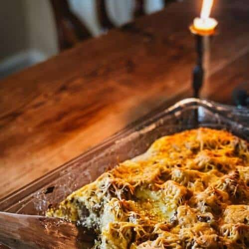 lit candle and  Hearty Sourdough Sausage, Egg, and Cheese Breakfast Bake