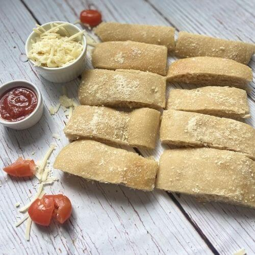 garlic parmesan breadsticks with cheese tomato and tomato sauce